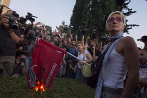Demonstration against the bailout deal - Athens Greece<br>13 Jul 2015, Athens, Attica, Greece --- July 13, 2015 - Athens, Greece - A protester burns a flag of the governing party SYRIZA. Hundreds gathered at Syntagma square in front of the Greek perliament to protest against the bailout deal primeminister A. Tsipras agreed to at the Euro Summit. (Credit Image: © Nikolas Georgiou/ZUMA Wire) --- Image by © Nikolas Georgiou/ZUMA Press/Corbis