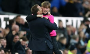 Duncan Ferguson embraces a ballboy during an Everton game against Chelsea.