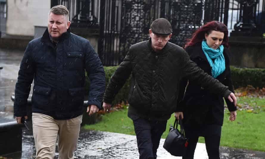 Paul Golding, left, arriving with Jayda Fransen, right,  at Belfast magistrates court.