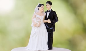 Picture of couple on top of wedding cake