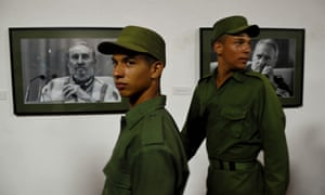 """Cuban soldiers visit the photo and audiovisual exhibition called """"Fidel"""", dedicated to Fidel Castro in Havana."""