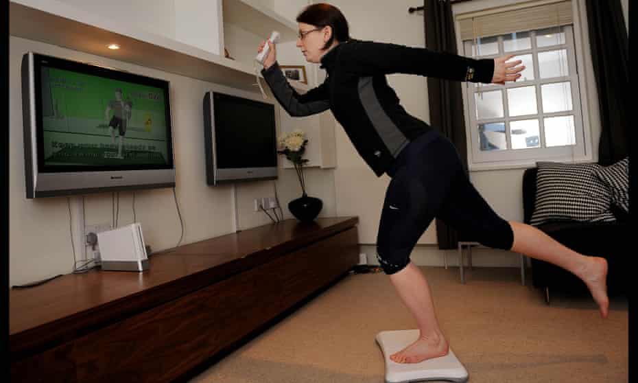 Woman doing an exercise on a Nintendo Wii Fit