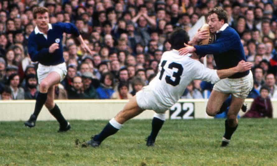 Scotland's Roy Laidlaw evades the tackle of Huw Davies on the way to scoring his superb solo try at Twickenham in 1983.