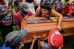 Mourners attend the funeral of Angelvis Gregorio Bello, a demonstrator who was found dead on the road between Cali and Palmira three weeks ago. Cali is the centre of protests against the government of Iván Duque that began on 28 April and have left 61 people dead
