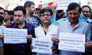 Kashmiri journalists hold placards during a protest in Srinagar on Tuesday. India banned publication of newspapers in the disputed territory for three days and raided newspaper offices.