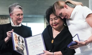 Leader of the Nobel committee Berit Reiss-Andersen, left, presents the award to Hiroshima survivor Setsuko Thurlow and Beatrice Fihn, leader of International Campaign to Abolish Nuclear Weapons in Oslo