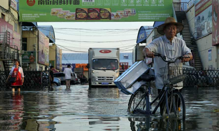 Flooding in Xinxiang in central China's Henan Province in June. The Intergovernmental Panel on Climate Change report said extremes such as heat waves, droughts, floods and storms would become more common across the planet as temperatures rise.