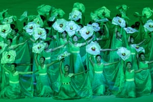Dancers dressed as flowers perform during the celebrations.