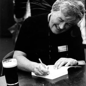 Dervla Murphy at a literary event … with a favourite tipple to hand (a pint of stout is to her right).
