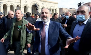 Nikol Pashinyan with arms outstretched surrounded by supporters