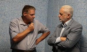Farm manager Scott Kirby talks to Jeremy Corbyn at Harper Adams University, Shropshire, on Tuesday.