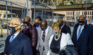 Al Sharpton (L), George Floyd's brother Philonise Floyd, attorney Ben Crump (4th L), Eric Garner's mother Gwen Carr, and NYC mayoral candidate Ray McGuire walk outside the Hennepin County Government Center this morning.