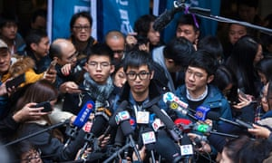 Wong (left), with Alex Chow (centre) and Nathan Law outside Hong Kong's court of final appeal, February 2018.