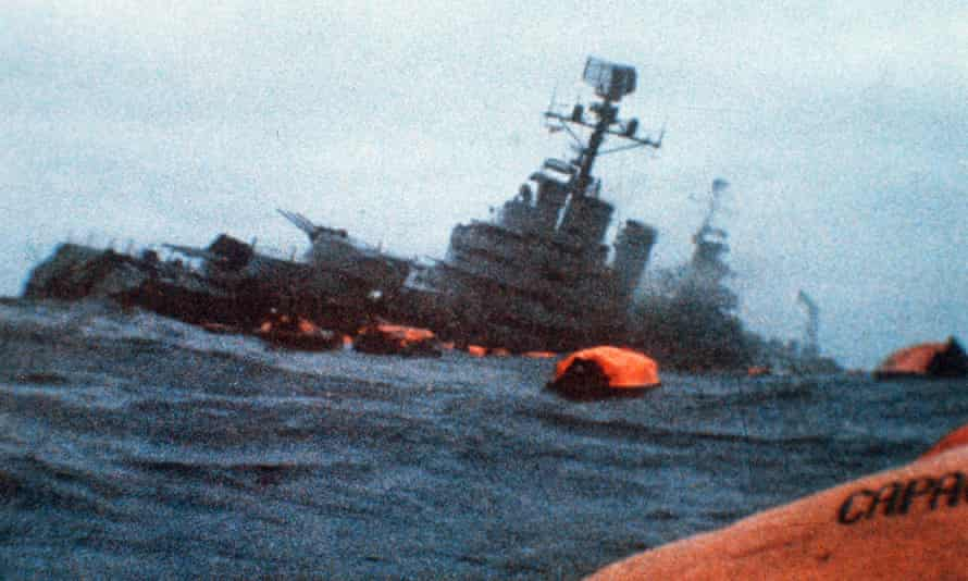 Argentinian cruiser General Belgrano sinks as orange life rafts carry survivors in the South Atlantic Ocean, 2 May 1982.