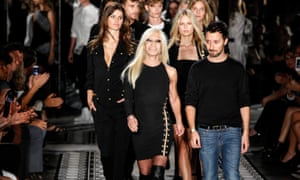 Anthony Vaccarello with Donatella Versace, on the catwalk after the Versus Versace spring/summer 2015 show.