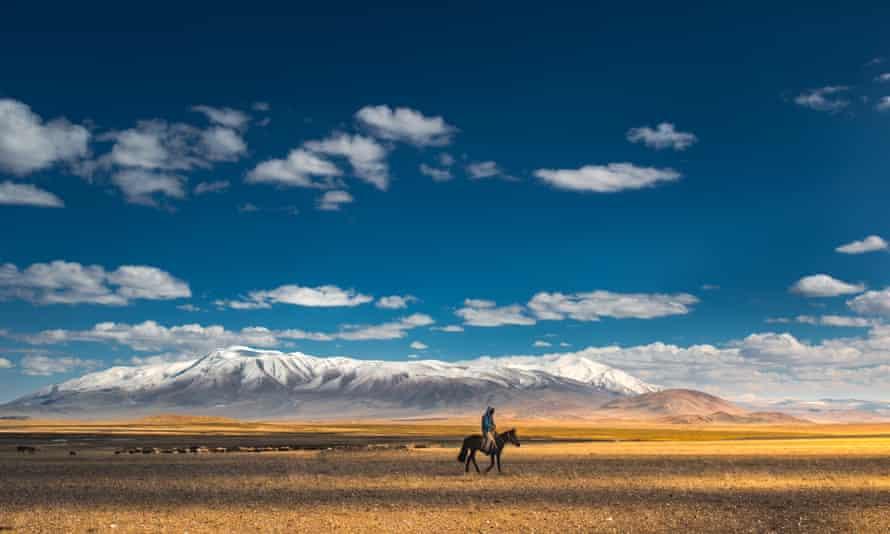 A nomad riding a horse, Khongoriin Els, Mongolia.