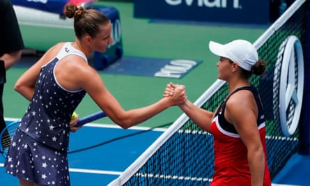 Ash Barty shakes hands with the much taller Karolina Pliskova.