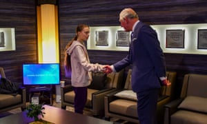 Britain's Prince Charles shakes hands with Swedish climate change activist Greta Thunberg at the 50th World Economic Forum (WEF) annual meeting in Davos.