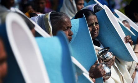 Indian women hold toilets as they participate in the opening ceremony of the three-day International Toilet Festival in New Delhi.
