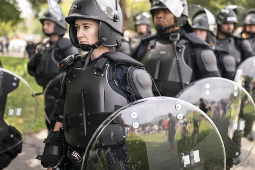 Police in riot gear observe the Justice for J6 rally near the US Capitol in Washington DC on Saturday.