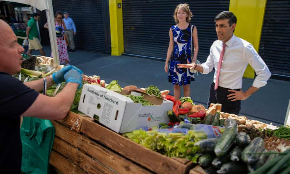 Rishi Sunak visiting an outdoor market in Westminster on 1 June.