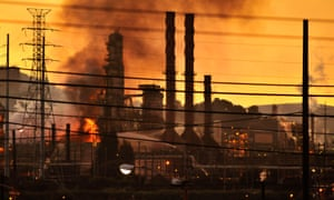 Firefighters douse flames at the Chevron oil refinery in in Richmond, California, in August 2012.