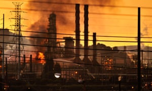 Firefighters douse flames at the Chevron oil refinery in Richmond, California