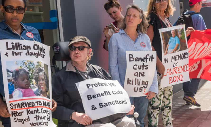 London, UK. 18th July 2017. People hold posters including two of people who died as a result of benefit cuts at the protest outside Kentish Town Jobcentre by WinVisible, Unite Community Camden, Kilburn Unemployed Workers Group, Single Mothers? Self-DefencJJA3CX London, UK. 18th July 2017. People hold posters including two of people who died as a result of benefit cuts at the protest outside Kentish Town Jobcentre by WinVisible, Unite Community Camden, Kilburn Unemployed Workers Group, Single Mothers? Self-Defence, Camden Momentum, English Collective of Prostitutes, All African Women?s Group, and others in Disabled People Against Cuts day of local actions across the country against the effect of benefit cuts and welfare reforms on the poor and in particular on the disabled. Credit: Peter Marshall/Alamy Live News