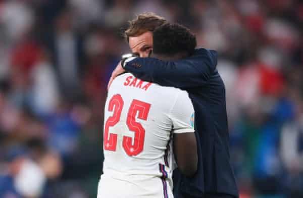 Gareth Southgate consoles penalty-taker Bukayo Saka on Sunday night.