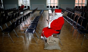 A man dressed in a Santa Claus costume attends an annual