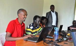 Jean Baptiste Bireha, left, in the Radio Inzamba newsroom in Kigali.