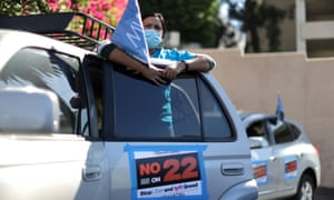 Leandra Montiel, 34, joins a protest by Uber and Lyft rideshare drivers against California Proposition 22, in Los Angeles, California.