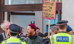 Extinction Rebellion protesters in front of police in London