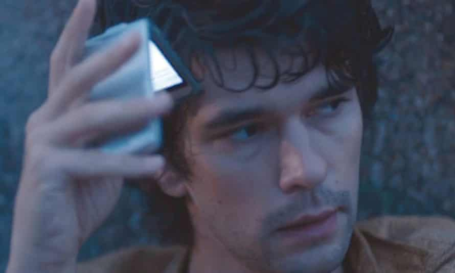 Ben Whishaw with his flip phone in London Spy