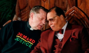 Father Michael Pfleger talks with Nation of Islam leader Louis Farrakhan at St Sabina Catholic Church in Chicago.