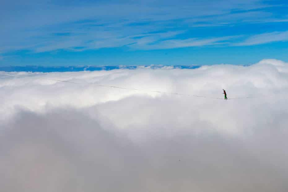 Samuel Volery, a professional mountaineer, balances on the 'highline' during the Highline Extreme event on the top of the Moleson mountain