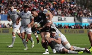 Sean Maitland of Saracens is tackled by Luke Charteris and Francois Louw at Allianz Park.