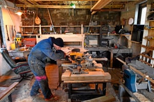 Stuart Taylor, one of the island's 30 inhabitants, in his workshop
