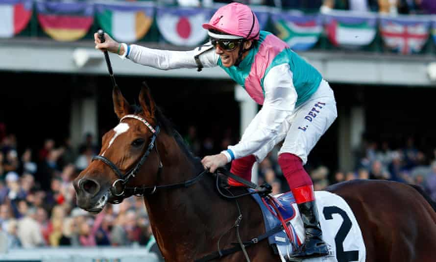 Frankie Dettori celebrates aboard Enable after getting past Aidan O'Brien's Magical in the final furlong.