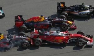 Ferrari's Sebastian Vettel of Germany is pushed by the Red Bull of Daniil Kvyat on the opening lap of the Russian F1 GP