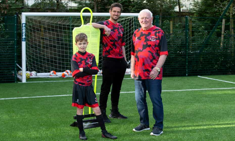 Jason Tindall with son Levi and his dad Jimmy in their Senrab 60th anniversary training shirts.