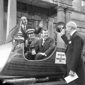 Richard Briers, Warren Mitchell (background) and Una Stubbs sit in the car from the film Chitty Chitty Bang Bang as they pose with the lord mayor of London, Ian Bowater, 1970.