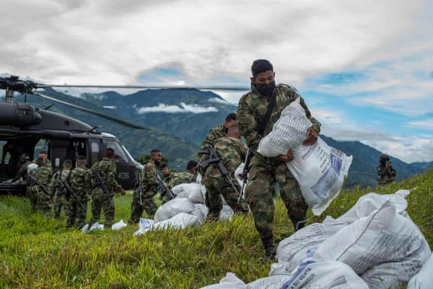 Colombian soldiers offload humanitarian aid from a UN helicopter for displaced people in Ituango on 27 July.
