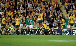 Australia players celebrate David Pocock's try.