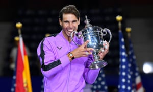 Rafael Nadal celebrates with the US Open trophy