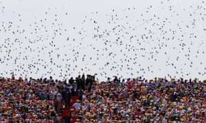 Thousands of doves are released during a parade commemorating the 70th anniversary of the end of the second world war.
