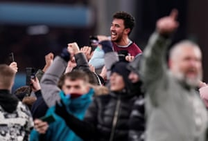 Aston Villa's Trezeguet celebrates after the match with their fans on the pitch.