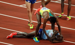 Mo Farah lies on the track after finishing second in the men's 5,000m final as the winner, Muktar Edris, reaches down to comfort him.