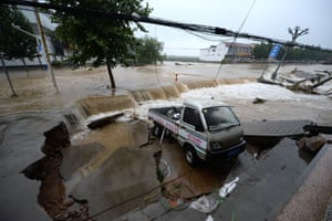 Ji'nan City, China A car is devastated by the floodwater due to rainstorms caused by Typhoon Lekima, the 9th typhoon of the year, in Ji'nan city, east China's Shandong province