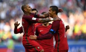 Ricardo Quaresma celebrates with his team-mates after scoring for Portugal against Mexico.